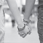 Teen couple holding hands in black and white