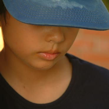 Child with baseball cap