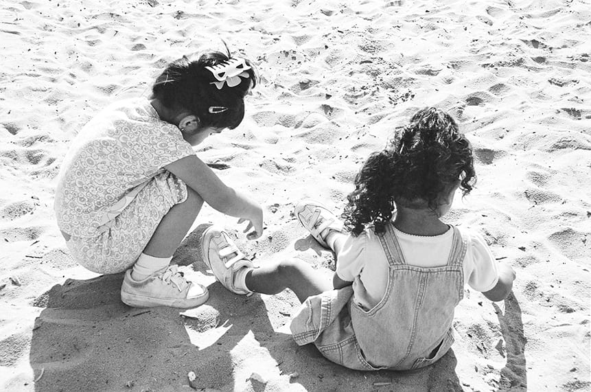 Young children plaing in the sand