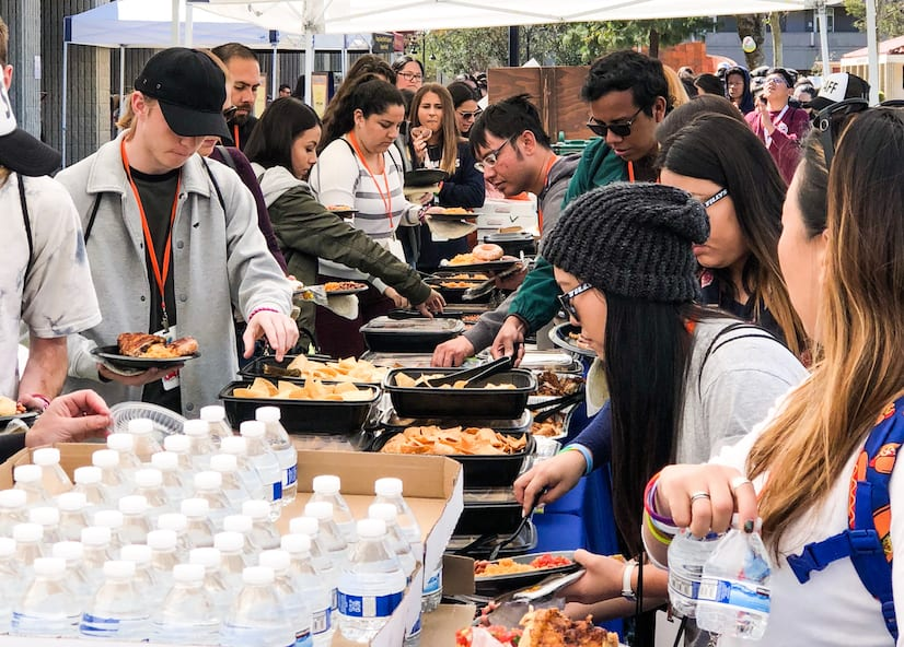 Festival of the Hearts attendees grab lunch provided by El Pollo Loco