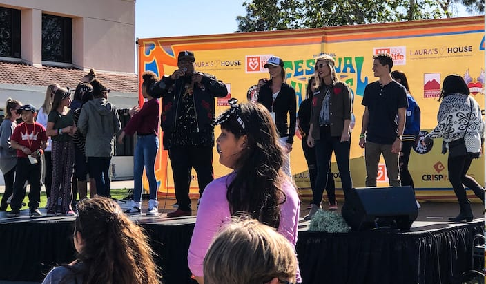 Prior to a performance by Latina hip hop band Bella Dose, their personal announcer got participants to dance on stage and gave away a cash prize